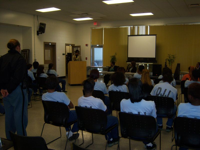 Marlo Hampton speaking to the female population at an Atlanta youth Detension Center.